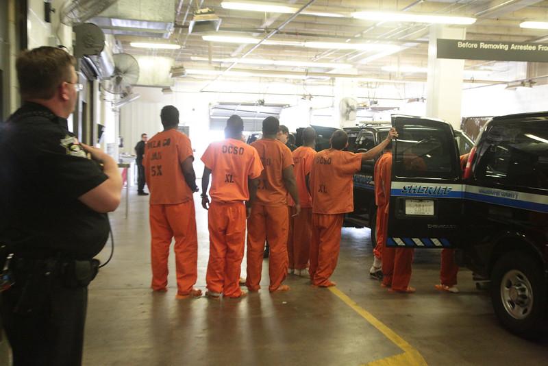 Inmates at the Oklahoma County Jail being moved to the Oklahoma County Courthouse for trial.