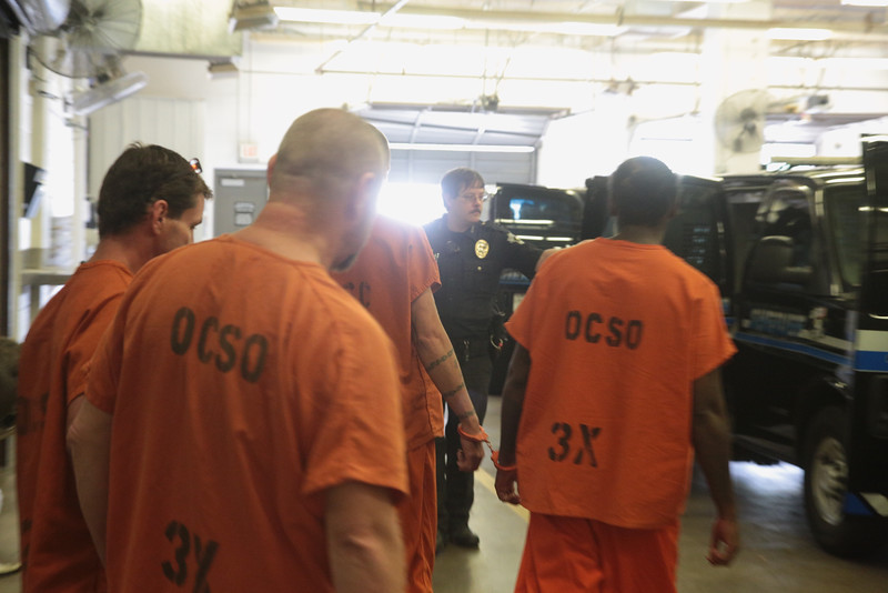 Inmates at the Oklahoma County Jail being moved to the Oklahoma County Courthouse for trial.