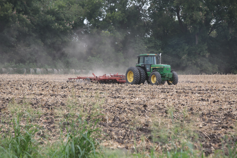 A cornfield being plowed in Harrah, OK.