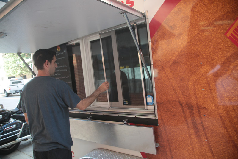 Cody Hail prepares the Urban Taco food truck before taking it out for lunch.