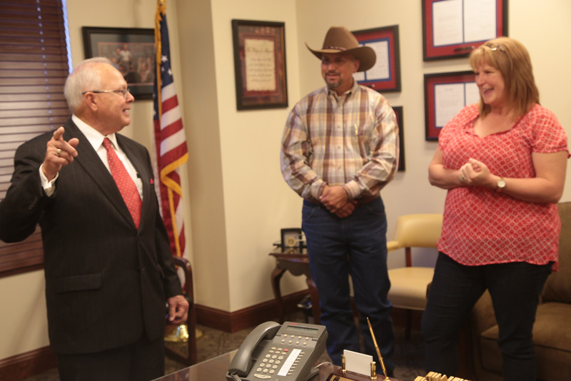 State Rep. Bobby Cleveland, R-Slaughterville, speaks with constituents at his Capitol office. The constituents live in a rural area near Lexington and have struggled to find a good source of drinking water.