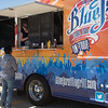 Michelle Spurlock, co-owner of Blue J's rolling grill, serving lunch in the parking lot of Hobby Lobby in Oklahoma City.