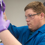 Hunter Nelson runs at test on oil contaminated water at the Oklahoma Department of Enviromental Quality in Oklahoma City.