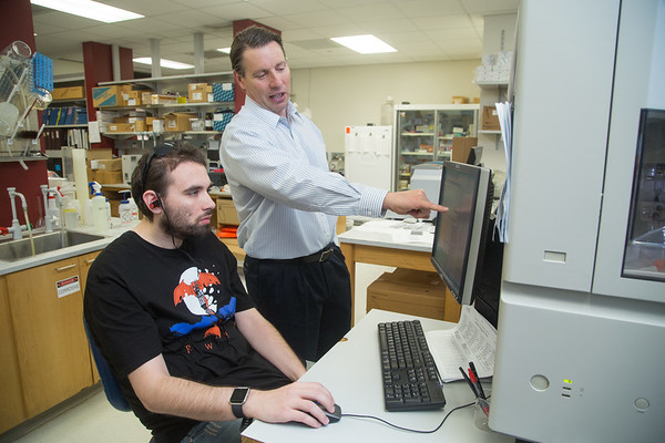 Sean Osborn, research technician at William Hildebrand's laboratory at the University of Oklahoma's Health Science Center, examines DNA data to match leukemia patients with possible bone marrow donors. Hildebrand signed an exclusive license agreement with AbbVie Inc., a biopharmaceutical company.