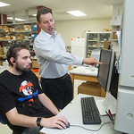 Sean Osborn, research technician at William Hildebrand's laboratory at the University of Oklahoma's Health Science Center, examines DNA data to match leukemia patients with possible bone mar ...