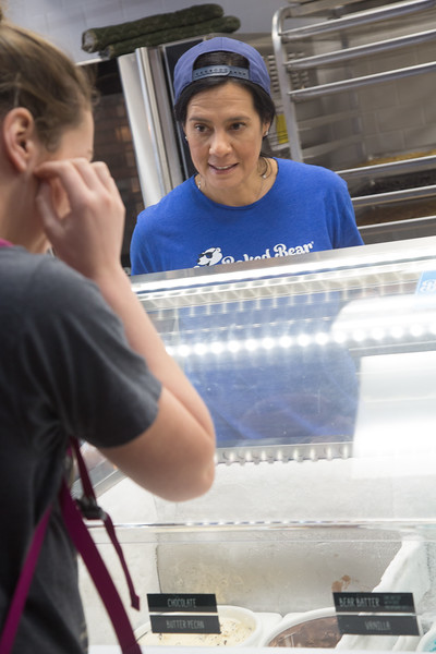 Co-owner Veronica Ingram prepares and Ice Cream sandwich at Baked Bear located at 731 Asp Ave. in Norman, OK.