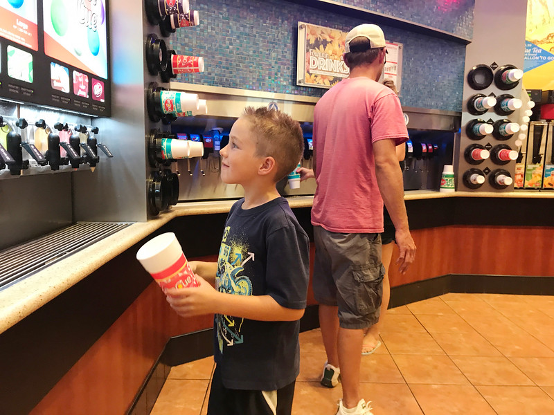 A boy deciding on frozen drinks at OnCue Express located on Waterloo Rd and I-35 in Edmond, OK.
