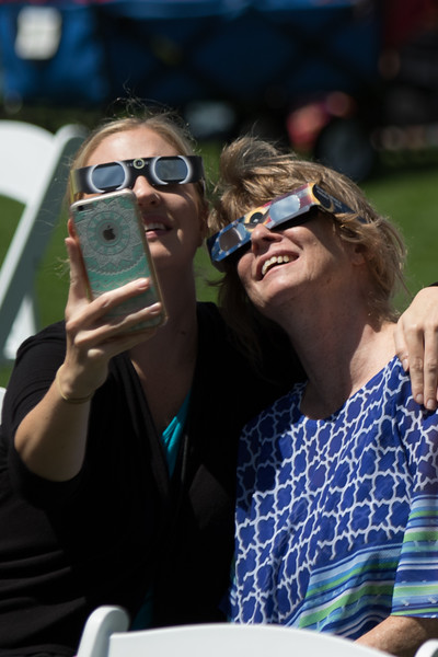 A large crowd of people gathered at the Myriad Gardens in downtown Oklahoma CIty to watch the solar eclipse that covered 84.4% of the sun.