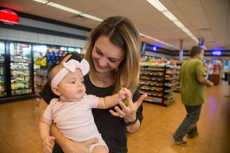 Laura Aufleger with her baby at OnCue Express at 5251 E Waterloo Road in Edmond, OK.