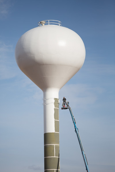 A new water tower being painted on Highway 62 just west of Blanchard, OK.