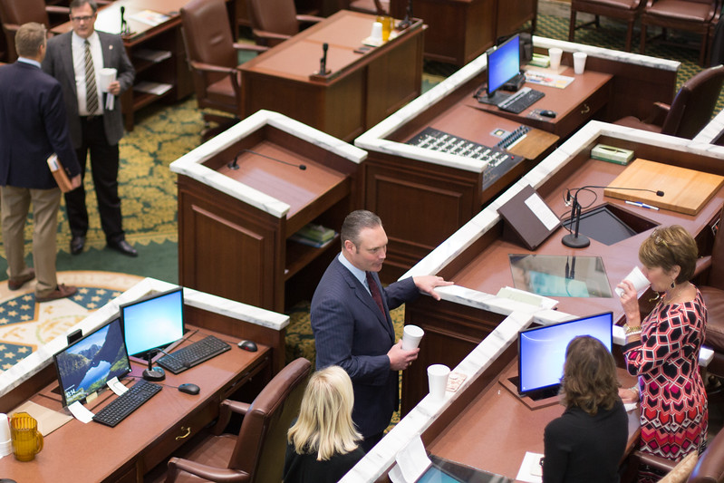 Speaker of the House Charles McCall (center) speaks to staff after a brief session at the Oklahoma State Capitol.