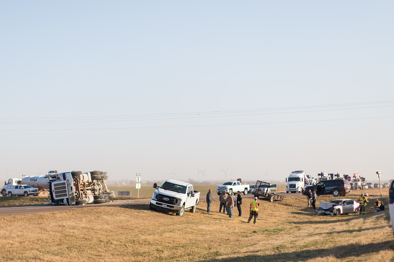 Emergancy crews respond to a crash site of an overturned semi hauling sand and sedan just south of Okarche, OK on Highway 81.