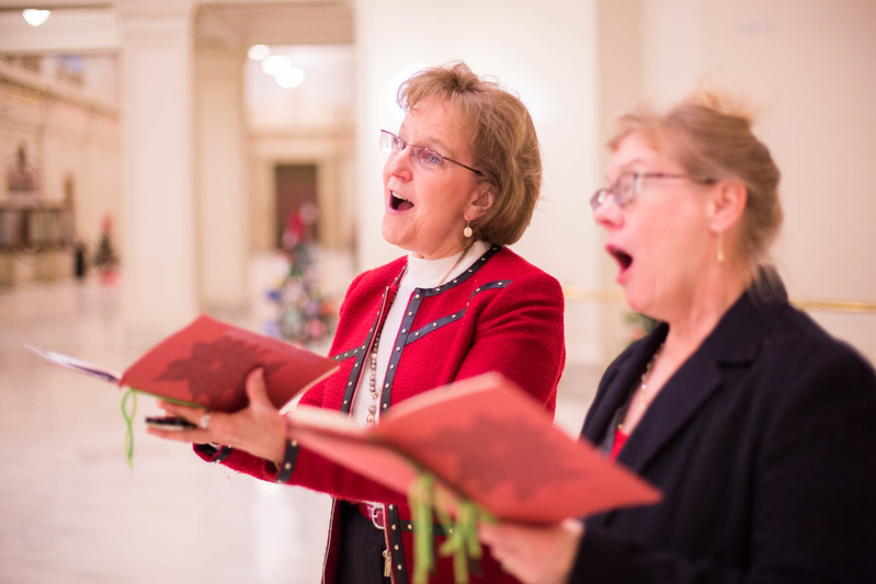 Anne Roberts and Lou Kohlman have made it their holiday tradition to roam the Oklahoma State Capitol singing Christmas carols.