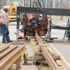Rails for Oklahoma City's new street car being made ready for instillation at SW 10th Street and Robinson, Ave.