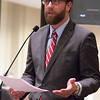 Oklahoma State Repersentive Jason Dunnington introducing a bill in a house comittee thet would provide overtime pay to state employees who make less than $40 thousand.