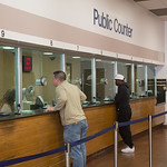 Tickets being paid at the teller window at the Oklahoma City Municipal Court Building located at 700 Couch Dr, in Oklahoma CIty.