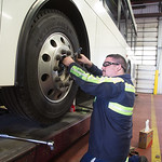 Paul Gonzalas works on replacing a wheal bearing on a Embark bus at the repair facility located at 2000 S May Ave. in Oklahoma City.