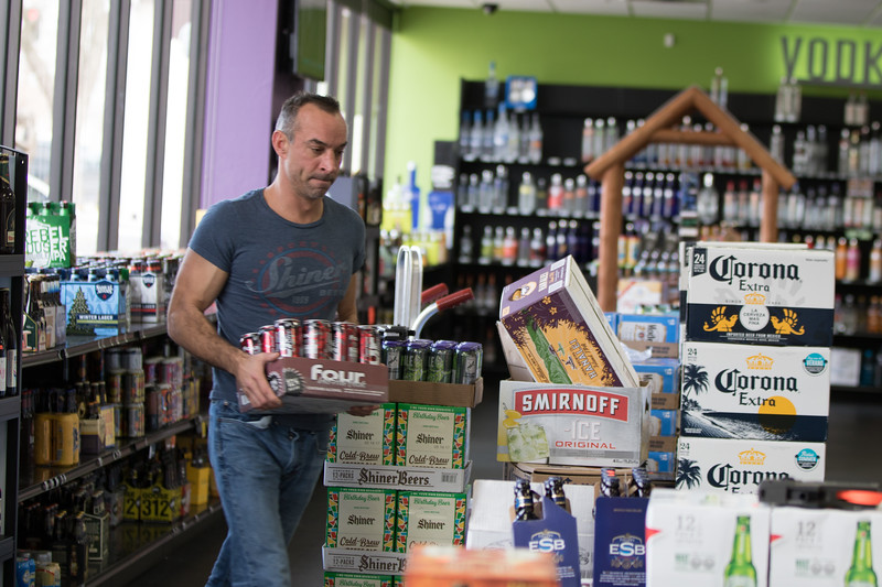 Product being stocked at Market Beverage Co. located at 204 S Littler Ave in Edmond, OK.