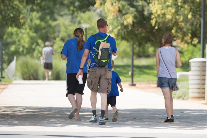 A family walking into the Myriad Gardens in downtown Oklahoma City.