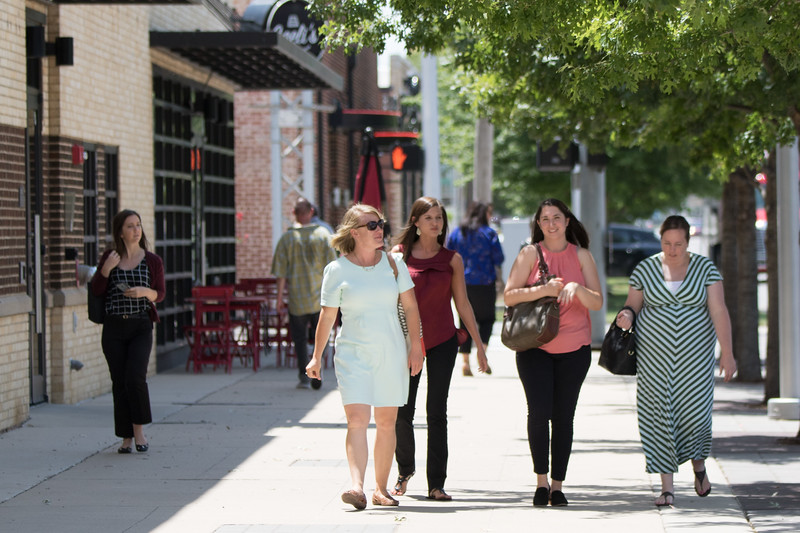 People walking along Sheridan Ave in downtown Oklahoma City.
