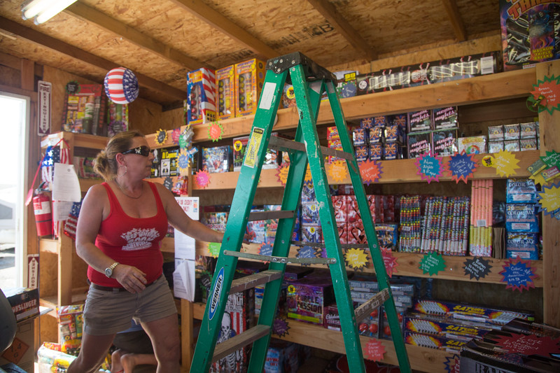 Wendy Lynn restocks fireworks at her stand located at 10927 NE 23rd Street in Nicoma Park, OK.
