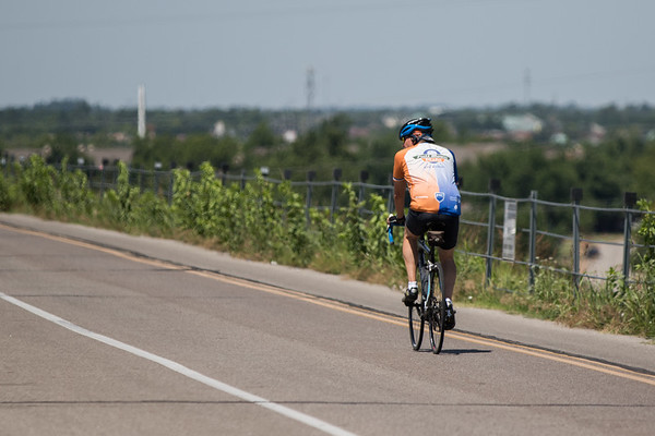 A cyclist riding around Lake Hefner located in northwest Oklahoma CIty, OK.