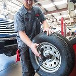 Brendan Jeffs balnces a wheel at Kennedy Tire and Auto Service located at 530 W Edmond Rd. in Edmond, OK.