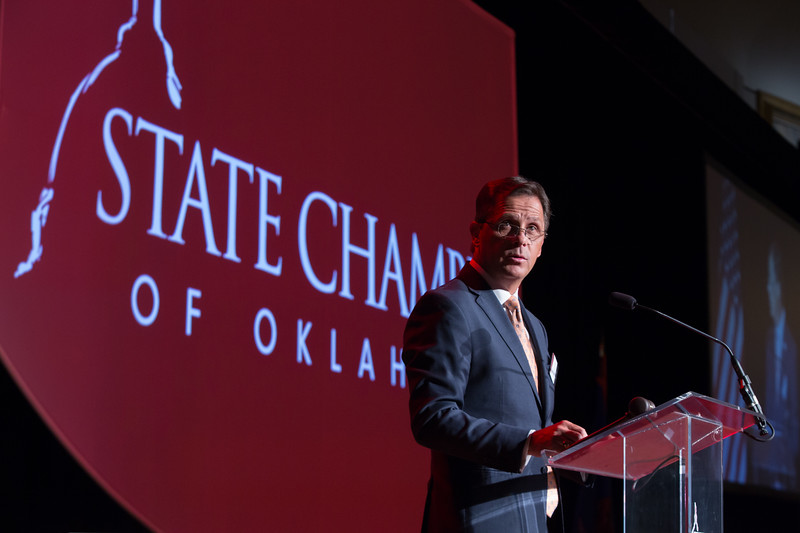 Sean Trauschke, CEO of OGE, speaking at the State Chamber of Oklahoma's annual luncheon held at the Oklahoma Cowboy and Western Heritage Museum in Oklahoma City.