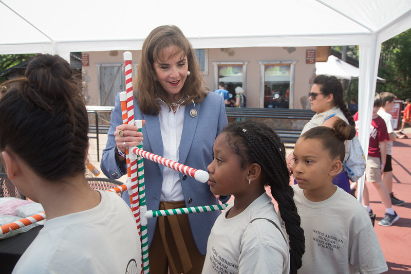 Oklahoma Labor Commisioner Melissa McLawhorn Houston  helps mesure children's hight to determin which rides they are eligable to ride at Frontier City located in Oklahjoma City.