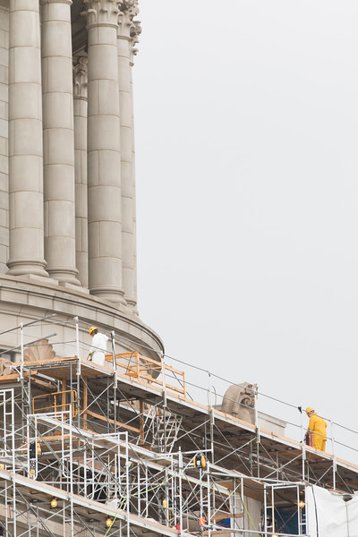 Two men use pressured water to clean the surface of the north side of the Oklahoma State Capitol  building in Oklahoma City.