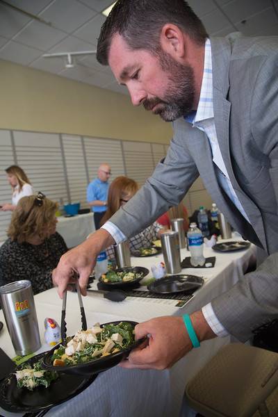 Oklahoma franchisee Marcus Tilly serves food for a tasting preview of PDQ coming to 1600 E 2nd Street in Edmond, OK.