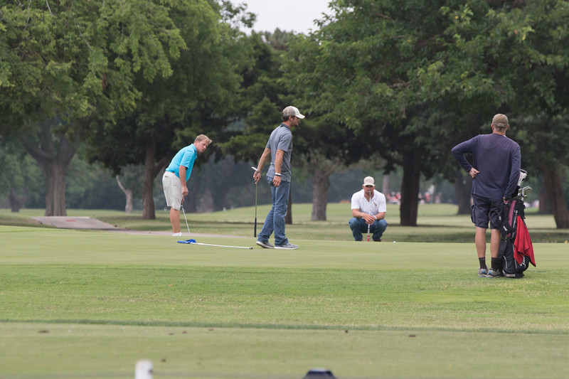 Men golfing on a rainy afternoon at Lake Hefner Golf Coarse in Oklahoma City, OK.