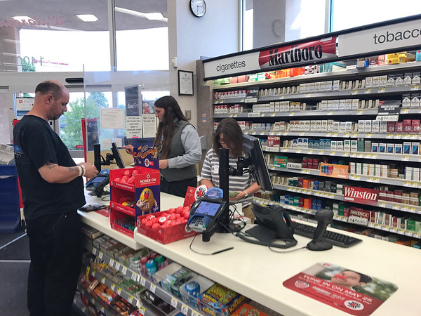 A man buying cigerettes at Walgreens Pharmacy located at 1400 E 2nd Street in Edmond, OK.