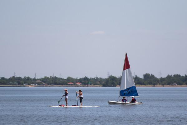 People on the water at Lake Hefner in northeast Oklahoma CIty.