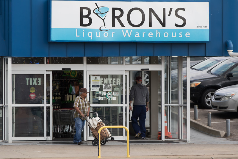 Customers leaving Byron's Liqour Warehouse located at 2322 N Broadway Ave in Oklahoma City.