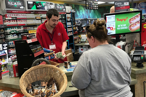 A woman buys three packs of cigerettes at a Circle K convienant store located at I-35 and 15th Street in Edmond, OK.