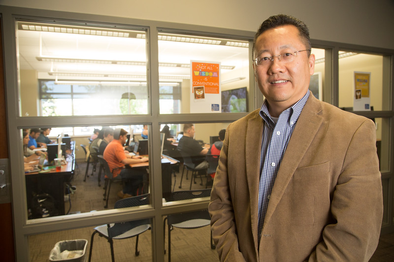 Proffessor James Ma outside of his class during a three hour test on investing at the Miender's School of Business at Oklahoma City University.