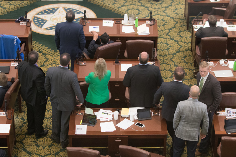 Members of the Oklahoma State House of Repersenitives waiting for the final votes on the final version of the state budget.