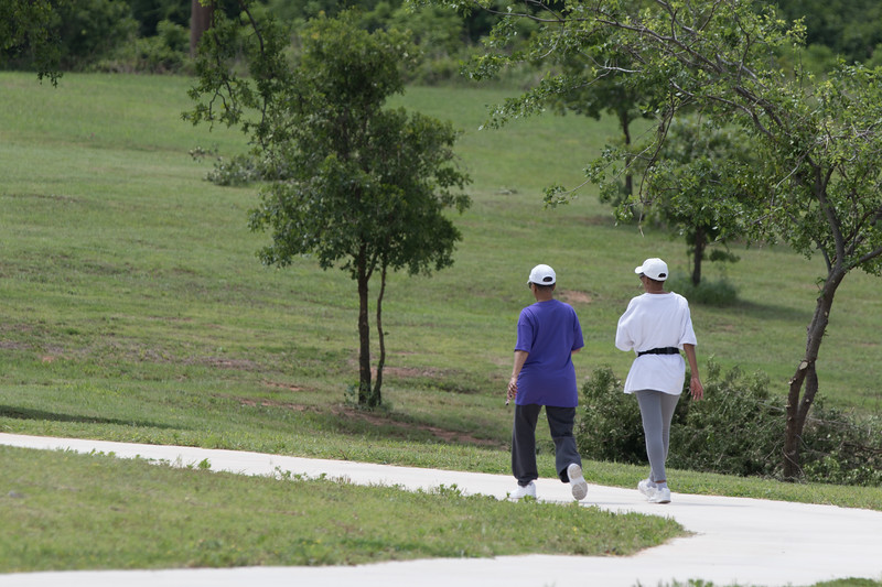 Two women walking at the wellness center at Oklahoma City County Health Department located at 2600 NE 63rd Street in Oklahoma City, OK.