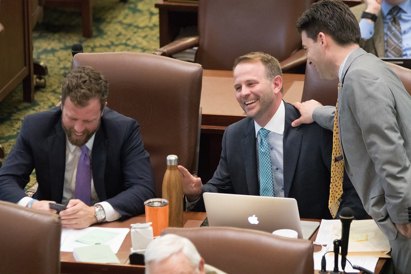 State Repersenitives Jason Dunington, Cory Williams and Eric Proctor on the floor of the House of Repersenitives at the Oklahoma State Capitol.