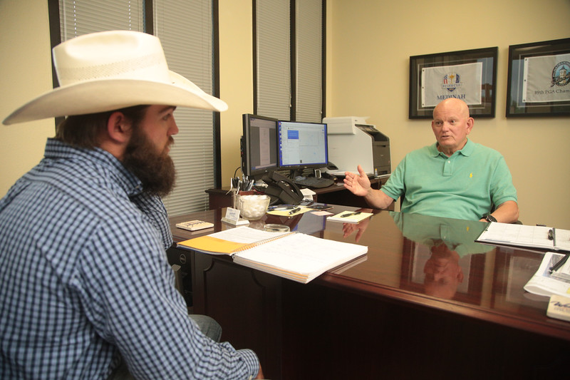 Sloan Smith, a student at Southwest Oklahoma State University, meets with Chuck Dougherty, Director of Economic Development for the City of Weatherford, OK.