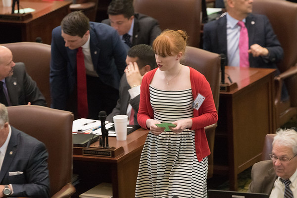 A page for the Oklahoma House of Repersenitives delivers a message during session at the Oklahoma State Capitol.