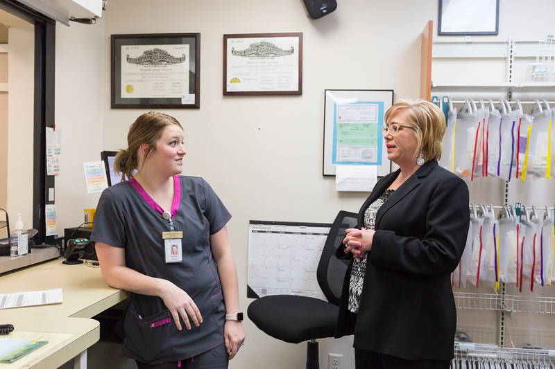 Verna Foust, CEO of Red Rock Behavioral Health, talks to Pharmacy Technician, Jennifer Busby, at the facility's Pharmacy on Tuesday, November 21, 2017 in Oklahoma City. (Emmy Verdin /Photographer)