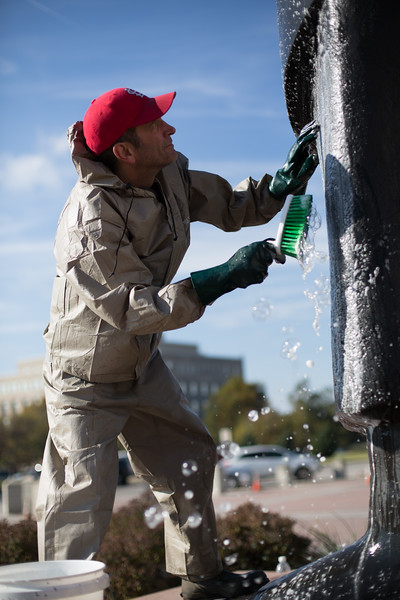 "Proffesional art cleaner Steve Boyd cleans the statue ""As Long as the Water Runs"" in front of the Oklahoma State Capitol in Oklahoma City."