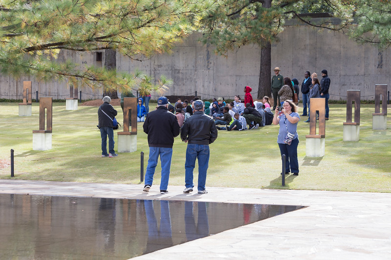 Linda Arambula takes pictures her family at the Oklahoma Bombing Memorial Park on Tuesday, November 21, 2017 in Oklahoma City. (Emmy Verdin/Photographer)