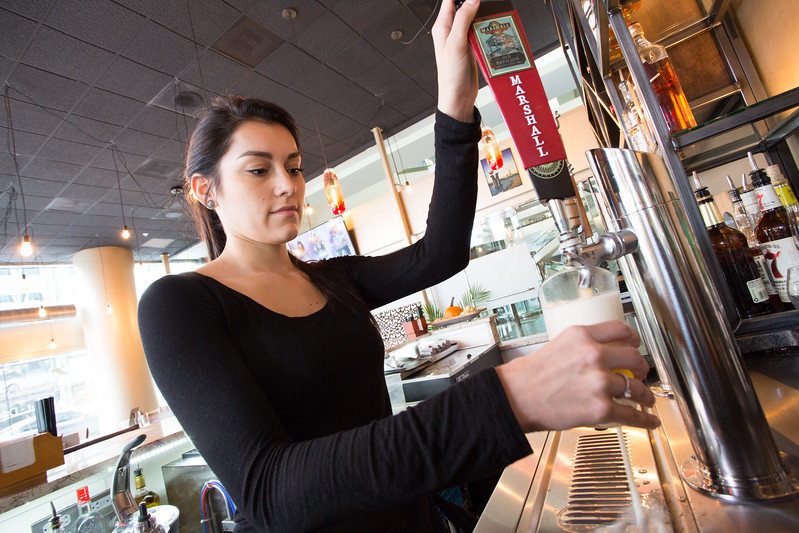 Jacquelyn Rojas purs a beer for a customer at The Manhatten located at 210 Park Ave in Oklahoma City.