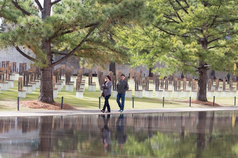 Jayla Wyatt and Adam Boyette walk along the water feature at the Oklahoma City Bombing Memorial Park on Tuesday, November 21, 2017 in Oklahoma City. (Emmy Verdin/Photographer)