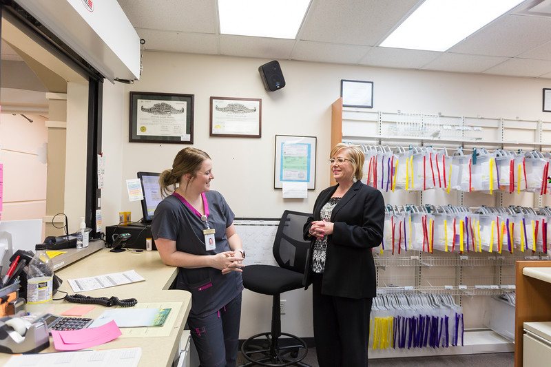 Verna Foust, CEO of Red Rock Behavioral Health, talks to Pharmacy Technician, Jennifer Busby, at their facility's Pharmacy on Tuesday, November 21, 2017 in Oklahoma City. (Emmy Verdin /Photographer)