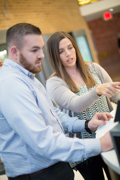 Chelsea Bradshaw helps Ben Pelley work with a customer at Citizens Bank of Edmond in Edmond, OK.