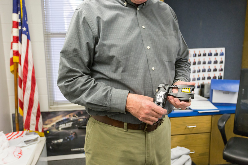 Captain Clint Caswell holds the taser model that will soon be replaced with an updated model at the Oklahoma Police Department Training Center on Wednesday, November 2017 in Oklahoma City. (Emmy Verdin/Photographer)
